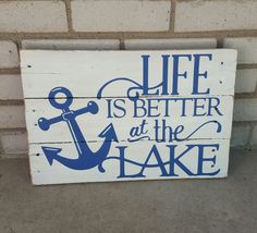 Life is Better at the Lake  Lake life is laid-back, relaxed and carefree. Show your love for life at the lake with this beautiful lake life pallet painting.  Made completely from reclaimed 1/2-3/4 thick pallet wood. Hand painted and distressed for a rustic look. It is then sprayed with a polycrylic finish and has D-rings or saw tooth hangers attached for easy hanging. This item is made to order, no two pieces are exactly alike. The photo shown is an item that was previously made and sold…