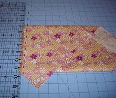 bias binding tutorial, how to fold the material for easy cutting on the bias! going to use this for sure.