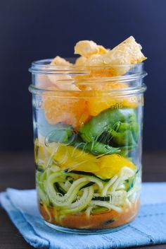 Asian Zoodle Salad Jars - Spiralized zucchini noodles, yellow bell pepper, sugar snap peas, mandarin oranges, crunchy wonton strips and sesame-ginger dressing.