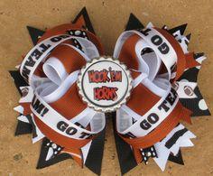 TEXAS LONGHORNS Hair Bow Boutique Style Texas Bottle Cap Hair Bow Football Zebra Print Sparkly Ribbon. $11.99, via Etsy.