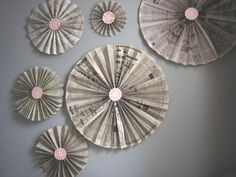 Wall Pinwheels. I would use #wallpaper instead of newspaper. But love the idea!   #tutorial @ site.
