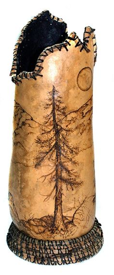 Gourd1.jpg - Sierra Moon: This gourd is lined with paper and painted on the inside. Wood burned mountains, moon and trees, on the outside wi...