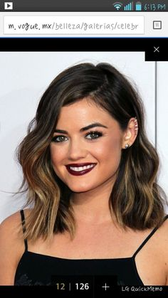 Lucy Hale's shoulder length ombré long bob haircut. One side tucked behind ear.