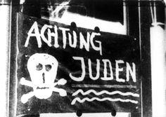 "Germany, November 1938, ""Achtung, Juden"" (""Warning, Jews"") written on a store window."