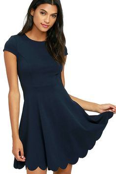 You won't need a picture to prove how cute you look in the Proof of Perfection Navy Blue Skater Dress, but you'll want one anyways! Medium-weight, stretch knit shapes a rounded neckline, and princess-seamed bodice, framed by cute cap sleeves. A twirl-worthy skirt ends in a scalloped hem. Hidden back zipper.
