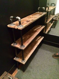 Shoe rack with barn wood and custom metal piping frame