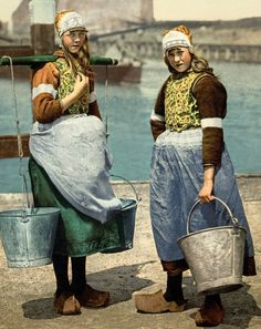 Bright and colorful vintage Dutch picture of two girls from the island of Marken, The Netherlands