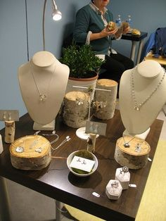 Good use of natural elements - wood logs to add layers to a craft fair display
