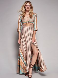 Peyote Gown | In a cotton-linen blend this maxi dress is featured in a tribal-inspired print with button closures down the front and a V-neckline. Three-quarter length sleeves and a slit in front complete the look.