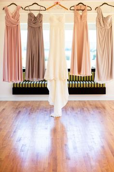 Wedding dress + bridesmaid dresses photo idea - hanging from ceiling {M.Studios}