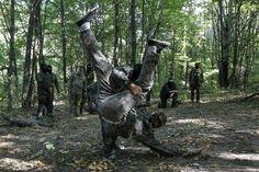 Pro-Ukrainian fighters wrestle during guerilla tactics training in a forest outside Kiev September 11, 2014. REUTERS/Valentyn Ogirenko