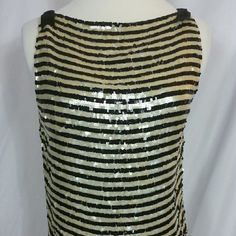 Anne Klein sz6 shimmery black & cream dressy top 100 silk & covered w/square plastic like sequins in black & white skinny stripes. Fabulous & sexy,  but cute @the same time. Eye hooks & closures up the side w/little bows on shoulders. Excellent condition,  doesnt look like it's been worn. Anne Klein Tops Blouses