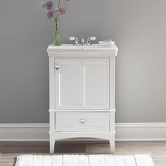 "Make the most of your small bathroom with the Landreneau 24"" Single Bathroom Vanity Set. This vanity features a large interior cabinet and one full extension slow close drawer. With stylish molding accents and a decorative framed door design, this vanity will complement a variety of decor styles. The arched open toe kick, tapered legs, and included vitreous china sink top complete the beautiful design."