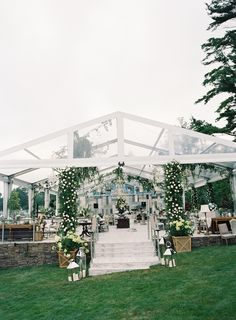 Alfresco Entrance at Tented Wedding   Photo: Tec Petaja. View More: http://www.insideweddings.com/weddings/childhood-friends-celebrate-wedding-at-marriott-familys-lake-house/866/