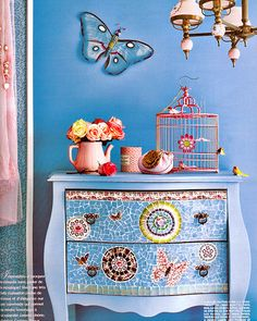 Love the color of blue used on the walls and the mosaic chest is gorgeous!