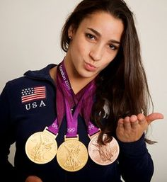Aly Raisman Aly Raisman blows a kiss for the camera during the 2012 Olympics. The gymnast won a team gold and individual gold and bronze medals. Team Usa Gymnastics, Artistic Gymnastics, Olympic Gymnastics, Olympic Sports, Olympic Team, Olympic Games, Gymnastics History, Women's Gymnastics, Olympic Swimming