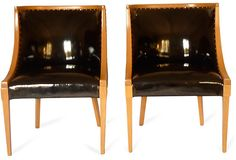 """As described by Stewart Design:  A pair of gorgeous black Dualoy patent-leather chairs with bleached oak frames and brass nail heads with a 16"""" seat height."""