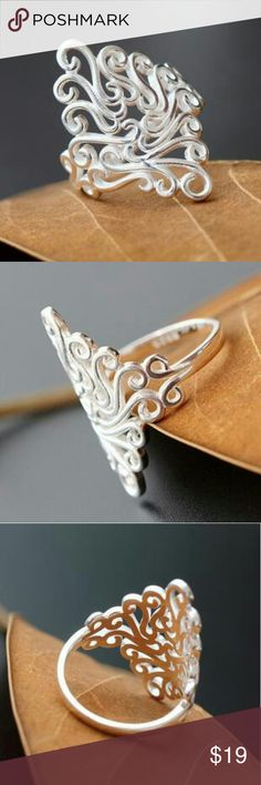 New Sterling Silver Intricate Filigree Wide Ring Gorgeous piece! Gorgeous filigree shiny silver ring.  Very delicate feminine ring. Looks great on any finger. Can even be worn as a midi or knuckle ring.  925 sterling silver, I believe, but they're not stamped.  Comes adorably packaged. Great for a gift or a treat for yourself!  This item is boutique branded and comes packaged as a boutique item.  Size 7 8 9 available.  Tags minimalist bar pave cross simple twist ring arrow simple girly cuff…