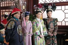 Actresses playing to roles of an Empress, a concubine and attendant, accompanied by a Qing prince in Court attire within the imperial palace.