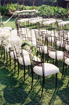 Wrought iron chairs draped with unruly blooms made such a mark against the green grass at @Mandy Bryant Dewey Seasons Resort Hualalai at Historic Ka'upulehu.