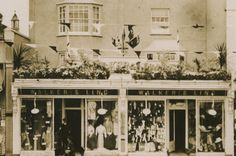 Our store front in 1911. Originally printed for the coronation!
