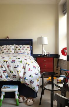 Adorable Boyu0027s Room With Navy Blue Bed With Silver Nailhead Trim Dressed  With Trains, Planes And Automobile Patterned Bed Linens Flanked By A Red  Three ...