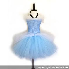 Cinderella Inspired Tutu Dress This beautiful tea lengthinspired tutu dress is made withlight blue tulle with white tulle on side and shoulders. Black ribbon