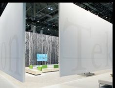 IDEX/NeoCon Canada show in 2009.     Sheathed in white, 16-foot-tall spandex-and-aluminum walls on four sides, the 30-by-40-foot exhibit enveloped attendees in a protective embrace. To define the space, Vanderbyl suspended the walls 18 inches off the ground, creating the illusion of a far bigger space than the 1,200-square-foot booth footprint.