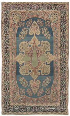 """LAVER KIRMAN TREE OF LIFE, Western Persian, 4ft 3in x 7ft 3in, 2nd Quarter, 19th Century. A highly collectible piece perfectly composed for use as wall art, this """"Tree of Life"""" pictorial antique rug achieves great dimensionality through its continually striated azure background. The simplicity of this very early 19th century Persian Kermanshah carpet veils a profound artistic maturity. Here flowers and buds are distilled to their elementary shapes with astonishing sensitivity."""