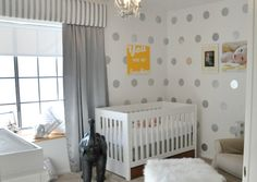 Michelle shares her innovative use of contact paper to create a polka dot nursery wall in her son's baby room and gives you all the steps to create your own.