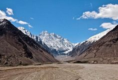 """Facing the end of Afghanistan 'demarcation' on the right and saying hello to Pakistan on the left before merging with China. The Karakoram Highway that connects China and Pakistan is somewhere behind these mountains.  Wakhan valley Tajikistan 