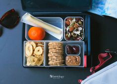 Snacks on Hand for easy travelling and those long shopping trips, banana chips, oranges, cheese stick, crackers, olives, almond butter, trail mix with coconut, lunch sleeve in argyle and Night bento box set