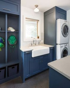 We love a blue mudroom with 4004 Raw Concrete countertops, but have you seen a kitchen with art as a backsplash? See all of Jameson Interiors' creative designs in this week's Designer Spotlight. All photos by Andrea Calo. Countertop Materials, Concrete Countertops, Little Cabin, Room Goals, Laundry Room Design, Design Firms, Mudroom, Backsplash, Creative Design