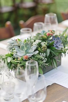 Add a variety of colorful succulent plants to a small planter as a cute and fun wedding centerpiece.