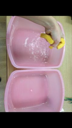 Displace water from one container to another using a sponge. Great hand strengthening