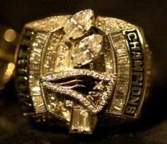 Super Bowl XXXVIII The New England Patriots Super Bowl XXXVIII championship rings, like the one shown in this photo, were distributed to players at a ceremony at the home of owner Robert Kraft in Brookline, Mass., Sunday, June 13, 2004. (AP Photo/Adam Hunger)