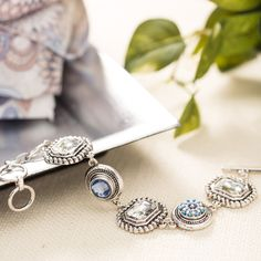 Antiqued Silver Ovation Bracelet with large Czech crystals and the Blue Zircon Solitaire and Beach Kaleidoscope Dots!  shanette.styledotshome.com