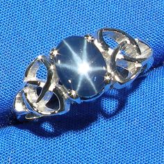 Blue Star Sapphire Celtic Triskel Ring, Hand Crafted Recycled Sterling Silve. $59.00, via Etsy.