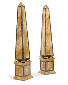 A pair of large Neoclassical style gilt-metal, lapis lazuli and Sienna marble obelisks - Dim: height 69 in.; width 13 in.; depth 13 in. 175.5 cm; 33 cm; 33 cm