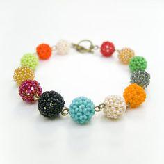 Разноцветные браслеты из мелких бисерных шариков . Каждый шарик собран мною вручную из монастырского бисера, т.е очень-очень мелкого. Диаметр