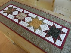 Hey, I found this really awesome Etsy listing at http://www.etsy.com/listing/118707204/winter-table-runner-scrappy-rustic-stars