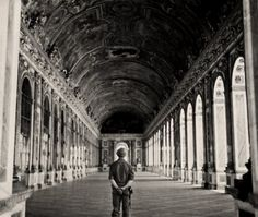 U.S. Private Conrey, one of the first to visit Versailles after its liberation, stands before the Hall of Mirrors. 1944.