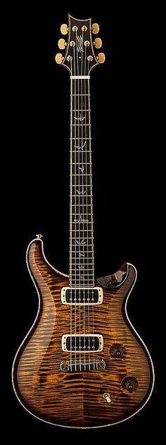 Reminds me a lot of PRS because of the inlays in the fretboard and the finish of the main body.