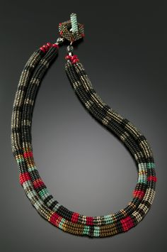 Anasazi Necklace by Julie Powell. Glass beads woven, bead by bead with a needle and fishing line. Czech, Japanese and Vintage European glass beads, African recycled glass and assorted stones. Handwoven toggle clasp. Limited quantities available.