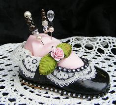 Altered baby dress shoe pin cushion