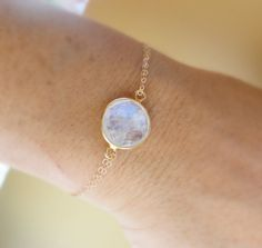 ON SALE Moonstone bracelet, bezel set gold fill moonstone jewelry, blue flash, blue fire, adjustable skinny bracelet. $29.75, via Etsy.