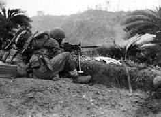 A US Marine firing a .30 cal machinegun on Okinawa island