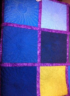 Back of X quilt, sun/star free motion quilted.