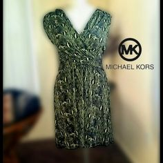 Michael Kors wrap style dress Stunning green and black snakeskin design. Falls right below the knee. Material stretches for a flattering fit. Michael Kors Dresses Midi