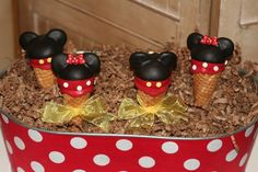 Mickey and Minnie cone cakes - use doughnut holes and candy wafers.